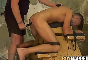 Restrained Dante Lucas roughly dildoed before handjob