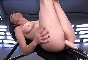 Brunette rides Sybian and undresses