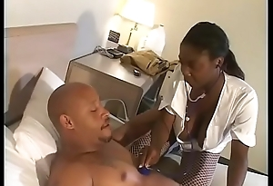 Black nurse Brown Sugar in fishnets enjoys her wet cunt penetrated gaping void by a huge pole