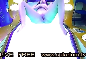 Horny Inclusive in the real public tanning salon masturbating on the solarium with a hidden camera filmed
