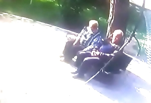 Old men open-air kissing gay to gay