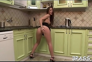 Catholic fingers her juicy snatch and pushes dildo inside of it