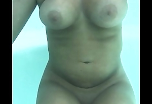 Intima Resort clothing optional Mexico nude beach pool