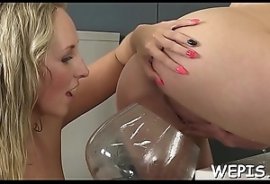 Bitchy cuties give a foot job to each other and make pissing