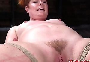 Chubby redhead caned by maledom master