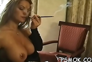 Sexy babe touches herself whilst relishing a cigarette