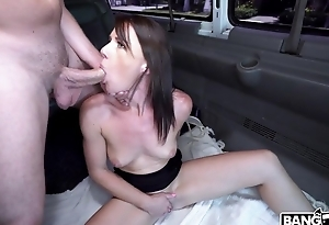 Brunette deepthroats a guy and fucks in the bus