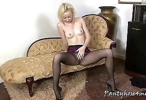 Slim blonde with firm tits poses in pantyhose