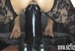 Sarah fucks a colossal dildo in her greedy pussy