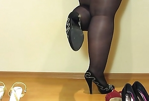 Foot fetish from beautiful bbw, cream on the feet and puffy legs in stockings in sexy high-heeled shoes.