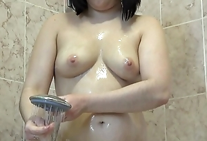 Brunette with juicy ass takes a shower and then masturbates with cream, hot fingering.